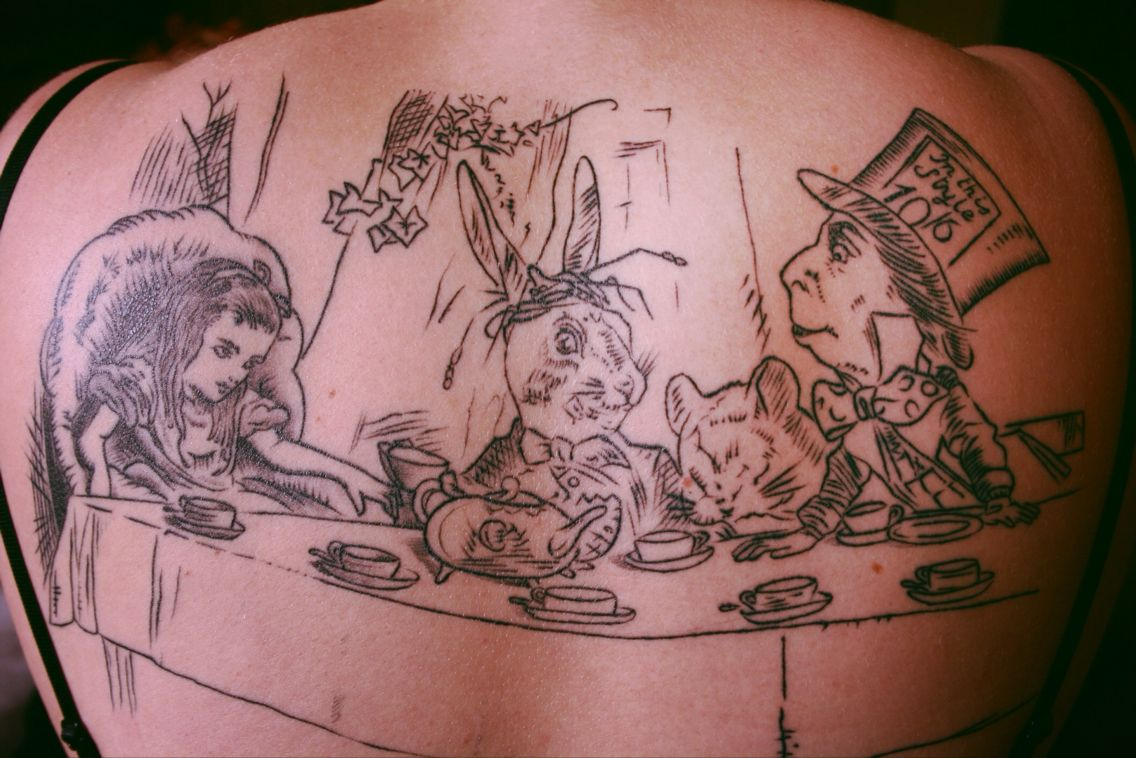 My own back tattoo, The Mad Tea Party (from Alice In Wonderland) In love with it!
