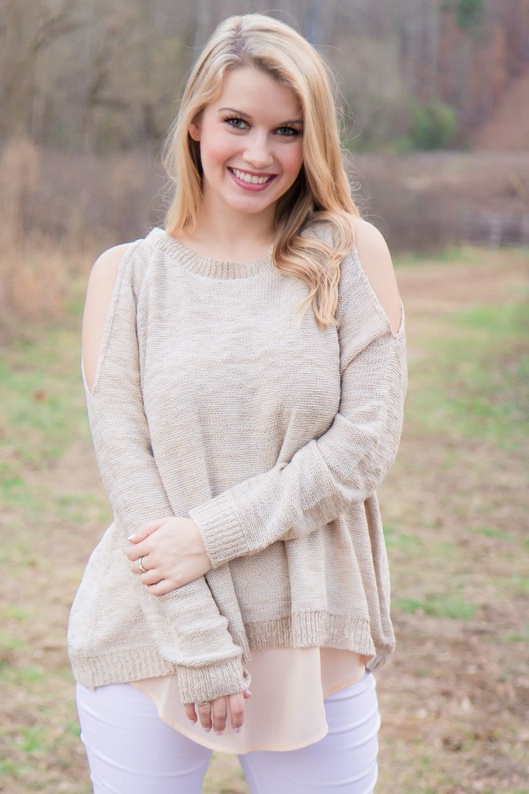 Worth the Wait Sweater  Vendor: AtType: TopsPrice: 48.00  Transition to Spring in this lightweight open-shoulder sweater. Sweater features a split back with a sheer underlayer.  Model wears a small.  Small fits 2-4. Medium fits 6-8. Large fits 10.