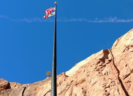 American Flag flies over Hoover Dam  Hoover Dam borders both