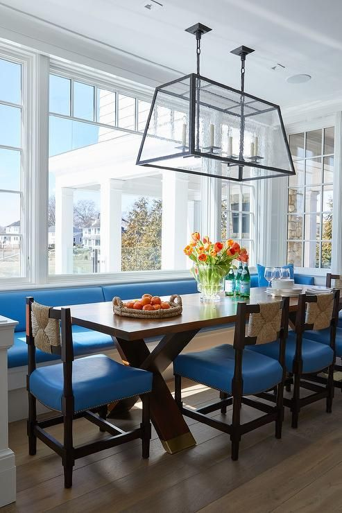 Long built-in banquette matched with blue vinyl seat ...
