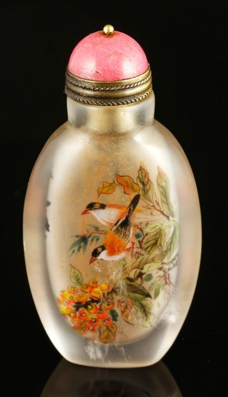 "Peking glass snuff bottle, China, the flattened elongated ovoid form decorated with a fine reverse glass painting depicting two songbirds on each side, one on the branch of a pomegranate tree, the other on a branch with berries, signed by Yie Zhongsan(1875-1945, 3 1/8""."
