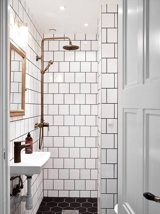 How To Pull Off This Easy To Clean Affordable Trend Square White Tiles Dark Grout Bathroom Inspiration Bathroom Design White Square Tiles