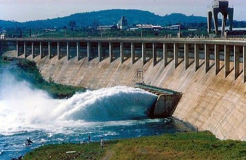Water gushing out of dam is from a sluice gate for ...