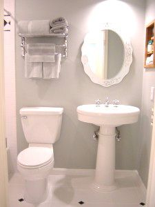 Small white bath with gray walls.
