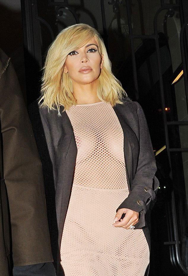 Kim Kardashian Bares Her Nipples In Sheer Top And Camo Shorts