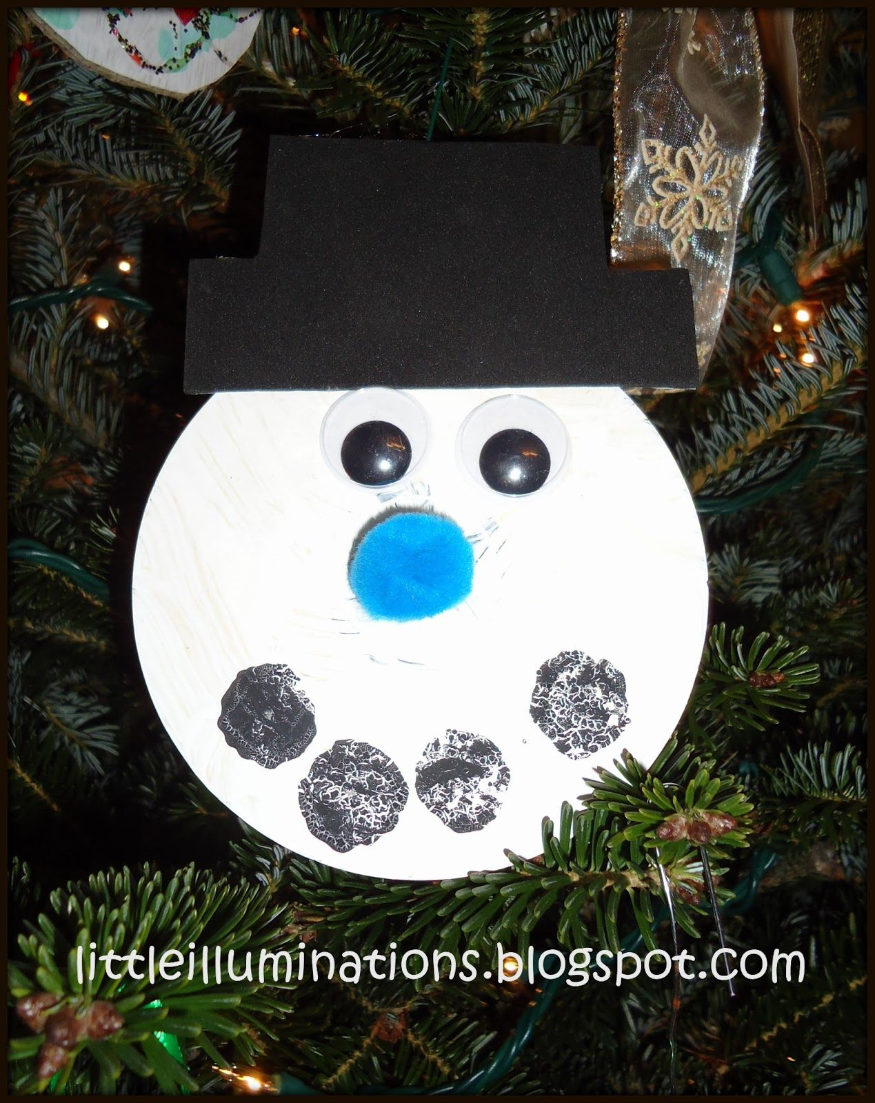 Have the kids paint an old cd with white paint. Add googly eyes, sequins,  pom poms or paint embellishments to make the snowmans ...