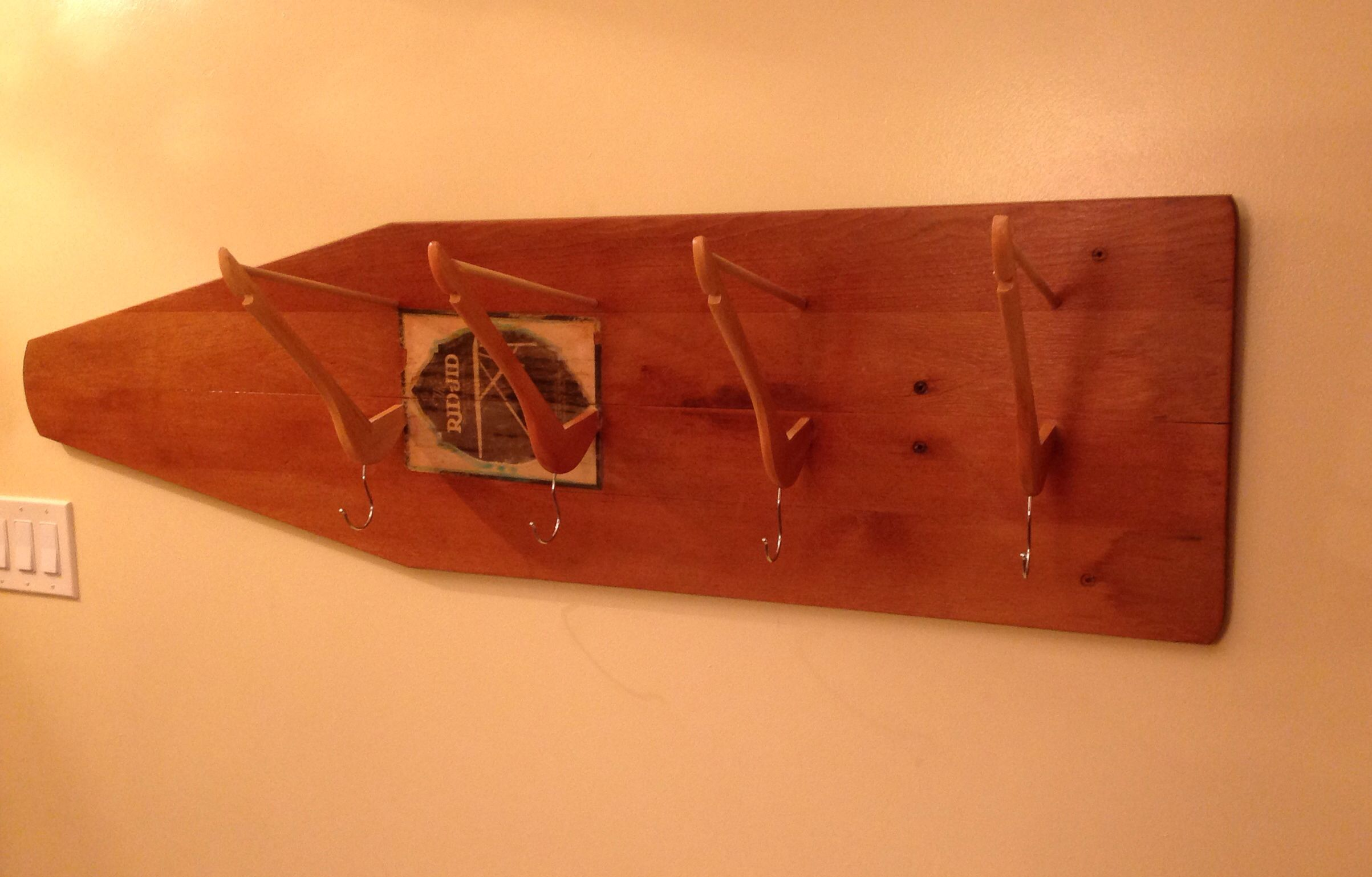 Coat rack from an old ironing board more at vendor on facebook