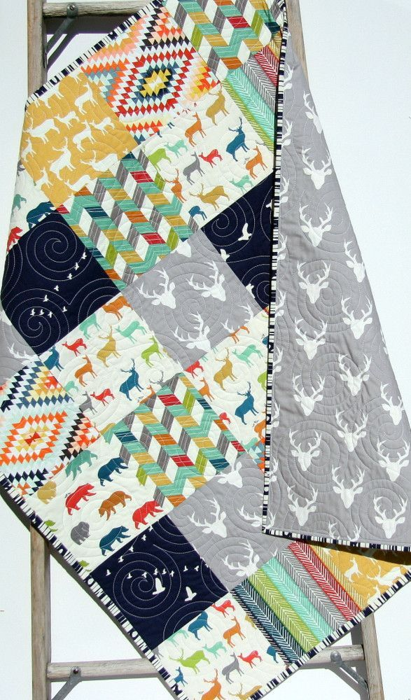 "Adorable modern boy quilt in navy, yellow, red and gray with bucks, deer, aztec, tribal, arrows, bear, and a modern rustic theme throughout. You can choose the size baby (34""x41"") or toddler (34""x54"")"