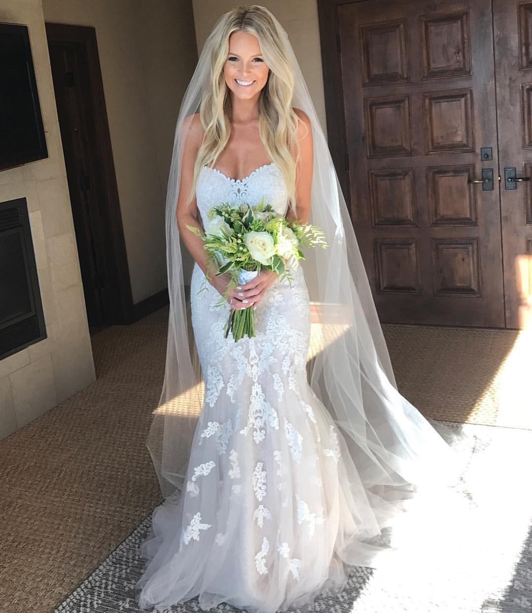 beautiful blonde bride - long beach waves hairstyle