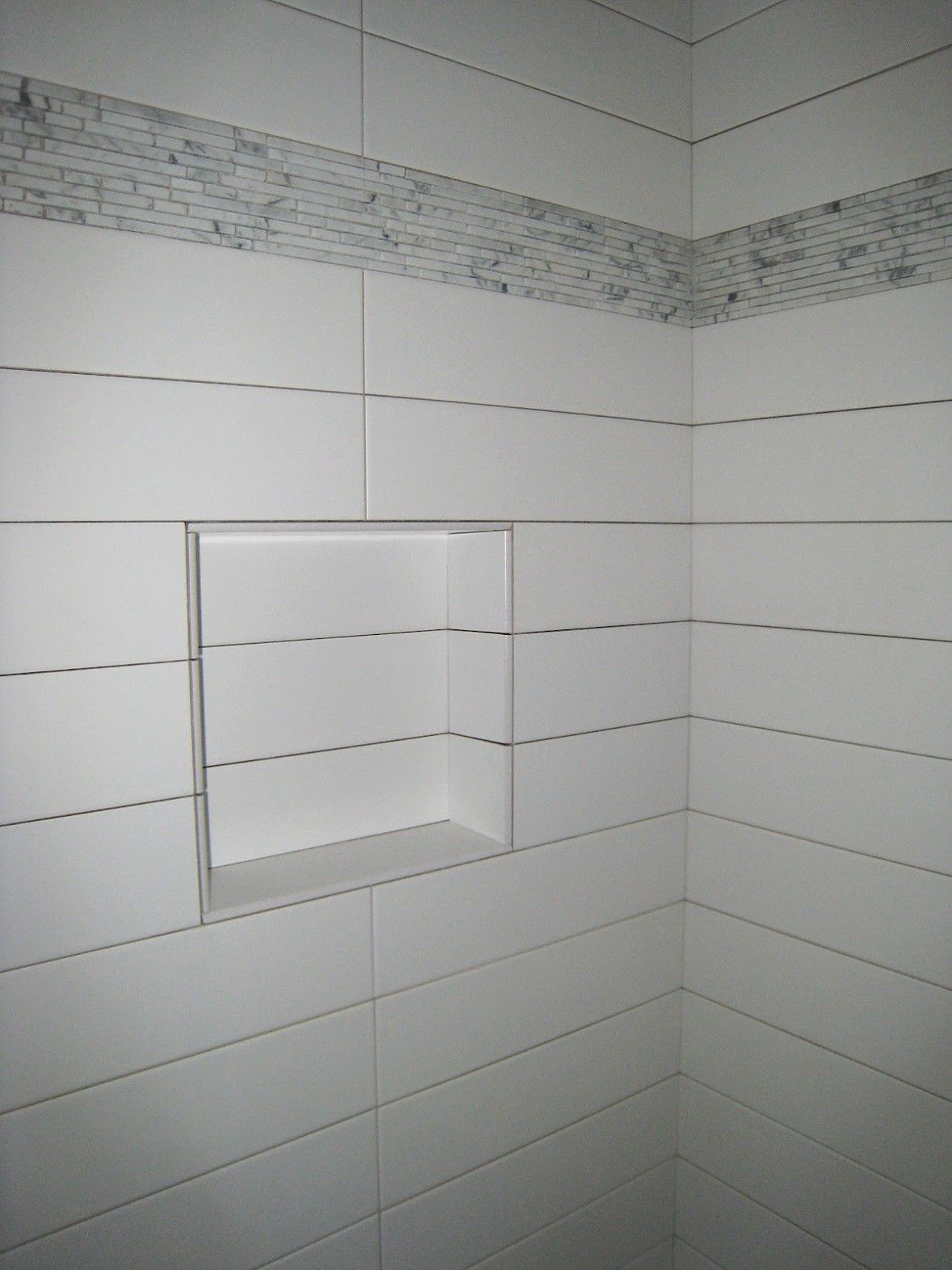 Stacked 10 x 4 white tile in bathroom with niche bathroom wall stacked 10 x 4 white tile in bathroom with niche dailygadgetfo Choice Image