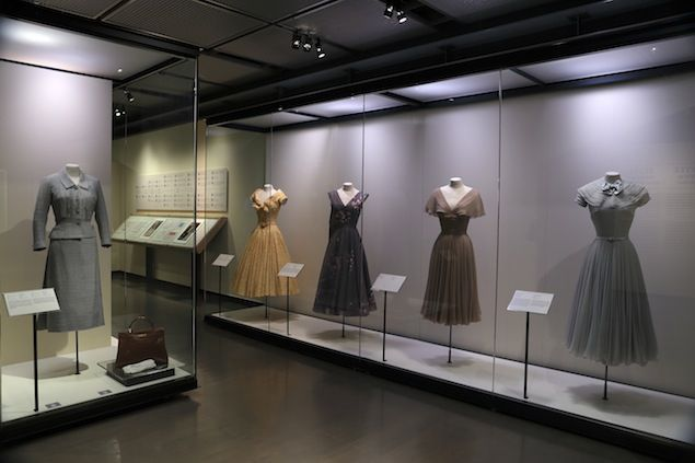 Grace Kelly's grey Hattie Carnegie dress is third from right in this photo of several of her gowns, which are on display at the Grace Kelly exhibit at the McCord Museum, Montreal