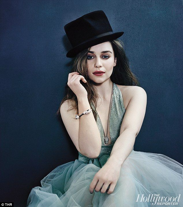 Red hot career: The actress, seen here in a black top hat and sea green dress with a plung...