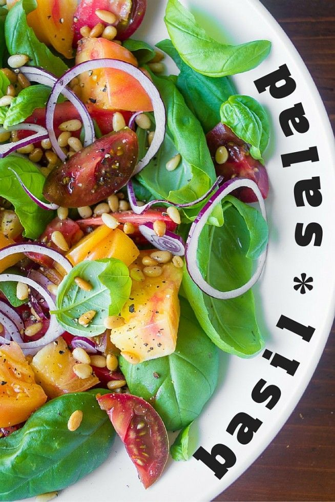 Basil Salad with Tomatoes is a celebration of mid-summer, when the basil is going gangbusters and heirloom tomatoes are in their glory days! | theviewfromgreati...