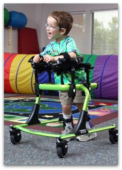 Small (K501) Rifton Pacer gait trainer being used by a kindergarten