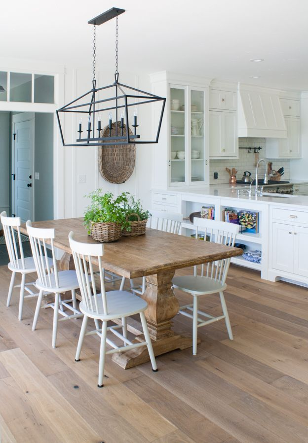 Lake house dining room with wide plank