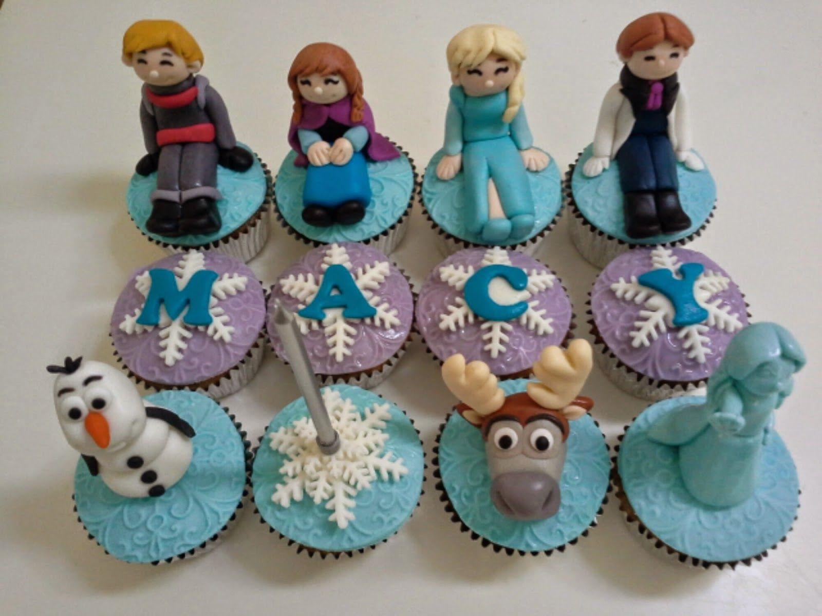 cupcake images for the movie frozen | Cupcakes decorados con celeste y blanco y encima, tarjetas circulares ...