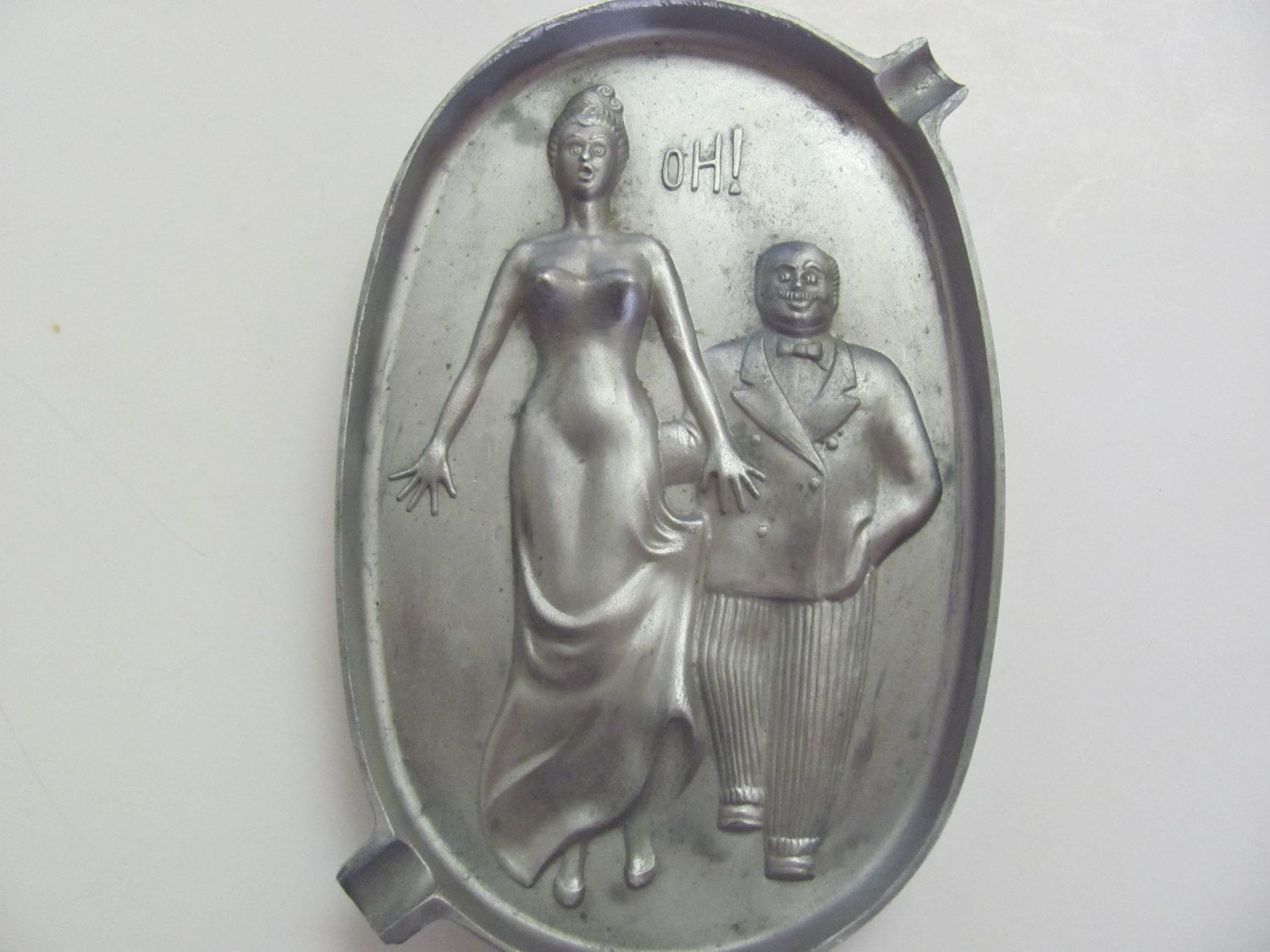 pair of vintage leather and  pewter ashtrays