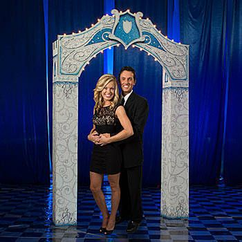 this dream come true castle arch features elegant silver swirls accented in blue with a shield