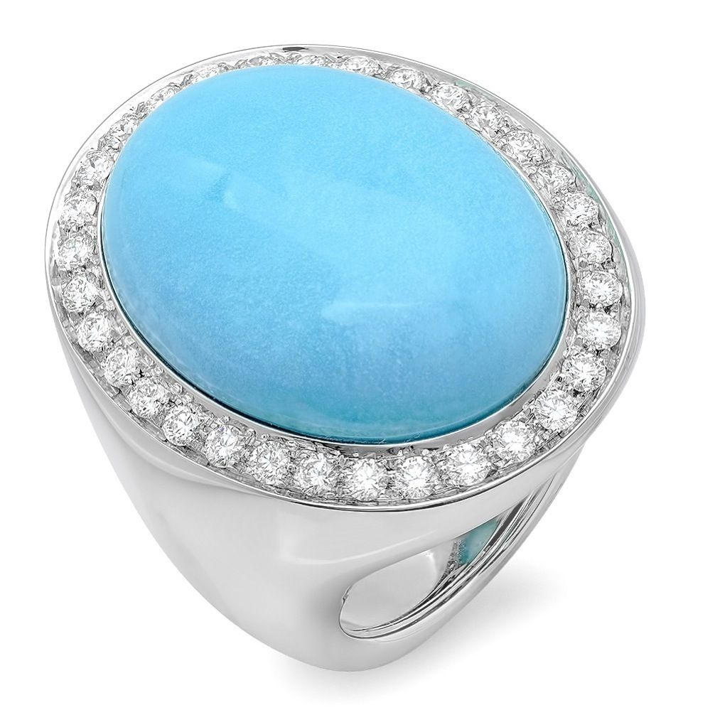An article in Women First magazine stated that rounded shape of an oblong stone, like this CB Luxe Turquoise & Diamond Ring, visually balances lengthy fingers.    $5,500 www.cbluxe.com