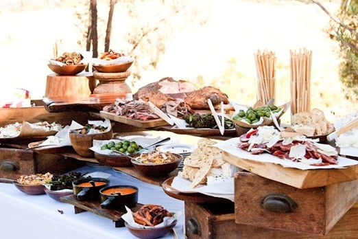 a rustic canap table with wooden boards of charcuterie