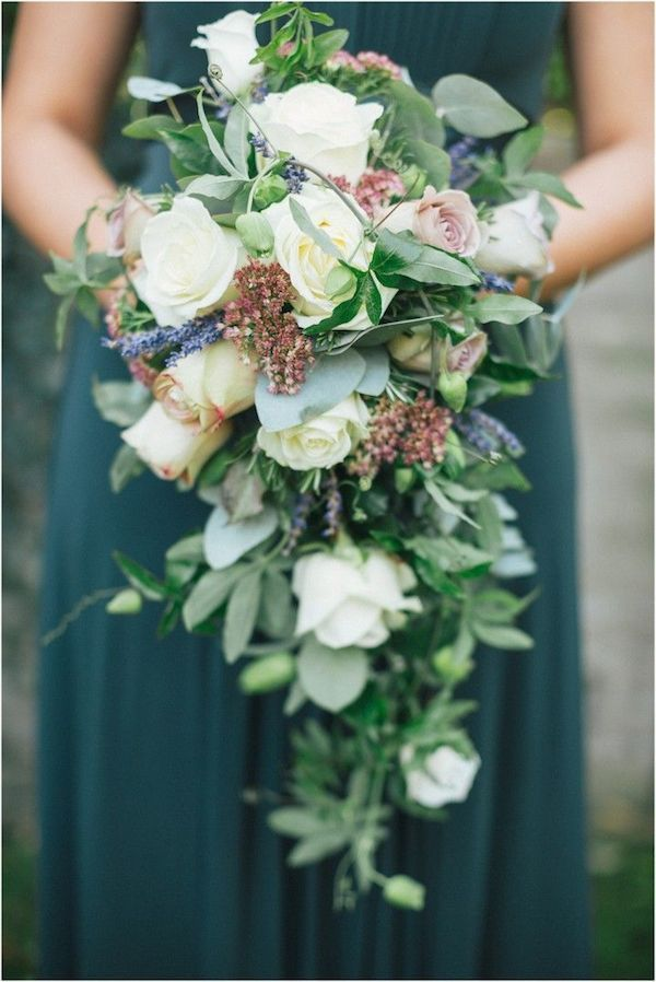 Love the cool colors! Blue green gown, lavender and roses cascading ...