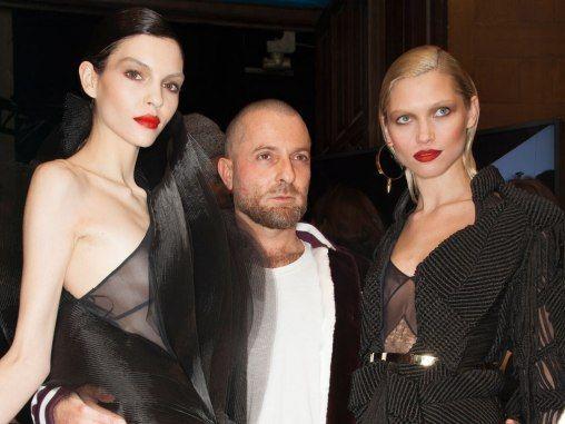 Models Hana Jirickova andKate Bogucharskaia with designer Alexandre Vauthier at Paris Fashion Week