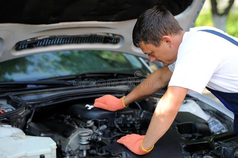 Car Mechanic In Auto Repair Service Royalty Free Stock Photo Car Repair Service Auto Repair Car Mechanic
