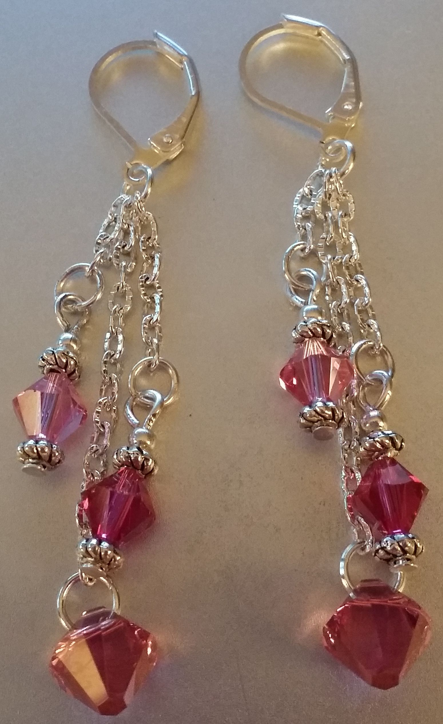 Rose and pink bicones make this pair of earrings sparkle! Priced at $20