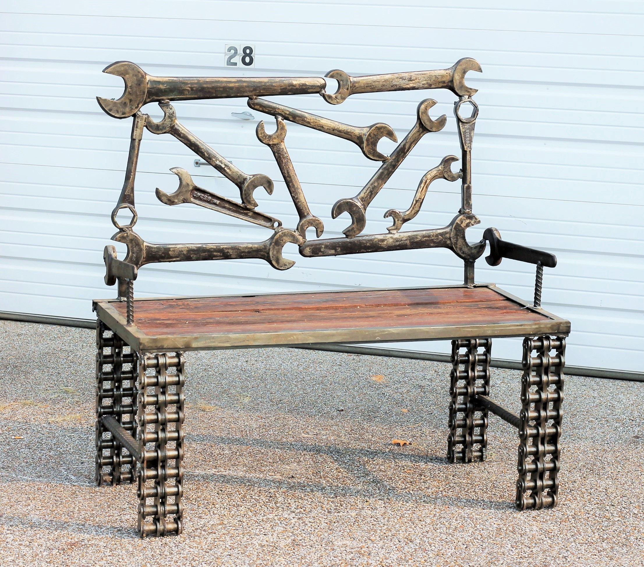 Scrap metal boom days oil field wrench garden bench for Repurposed metal furniture