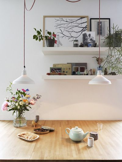 Floating Shelves Behind Dining Table With Hanging Light