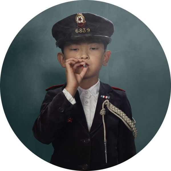 From serie Smoking Kids by Frieke Janssens.