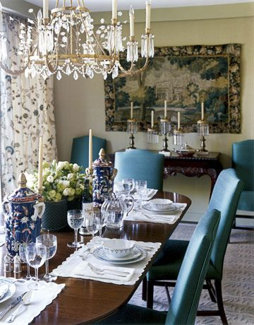 This dining room is dazzling mix of blues and greens. Chairs covered in 24 Karat in Seaspray by Silk Dynasty; curtains are Cowtan & Tout's Sherian; the pair of antique urns and the candelabra on the console under the French tapestry are from Martin Alexander.