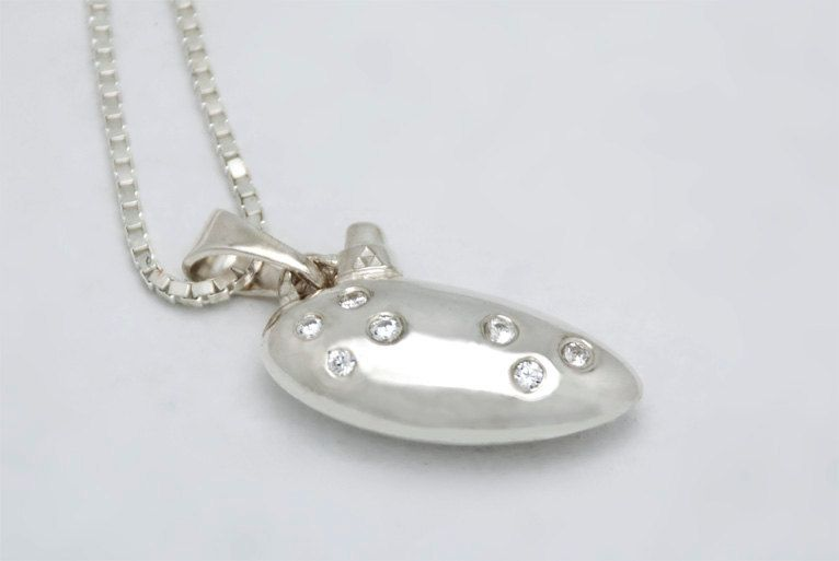 Zelda Ocarina Pendant I want this so bad ; I would wear it every single day for ever