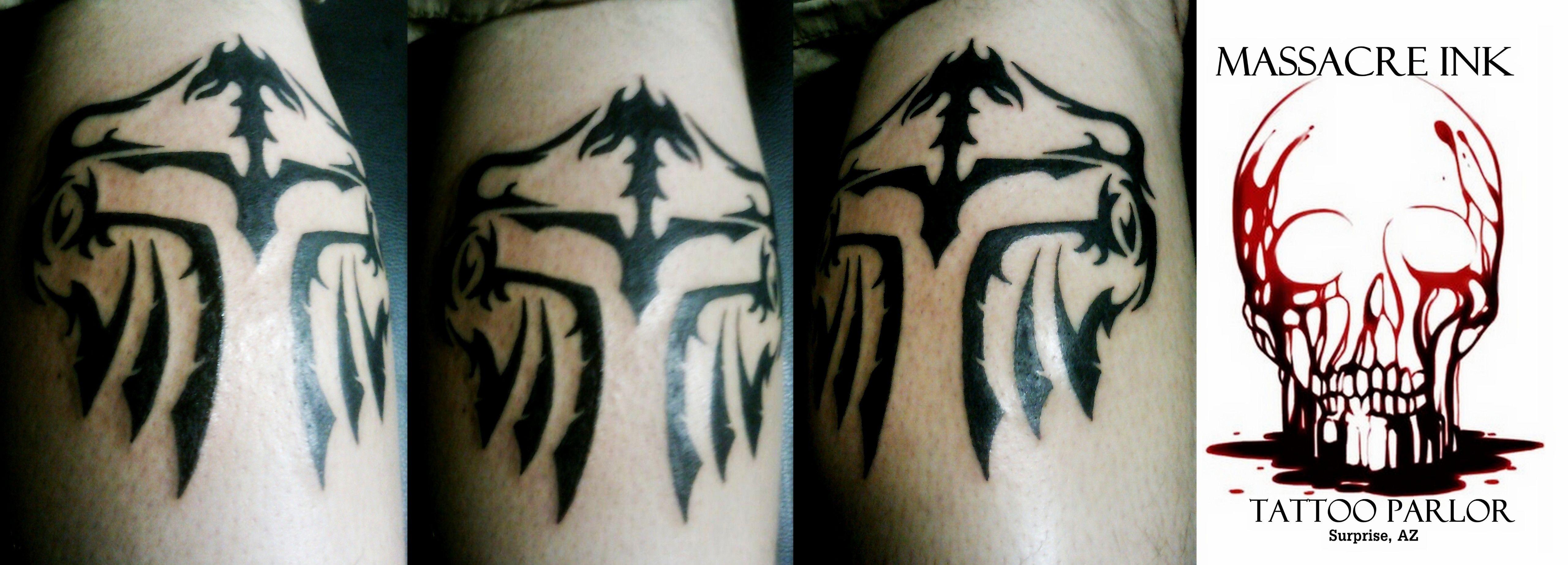 spartan tribal symbol for victory massacre ink tattoos