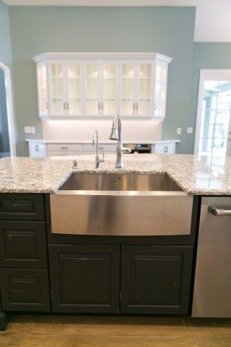 Stainless apron-front farmhouse sink in the center island of a