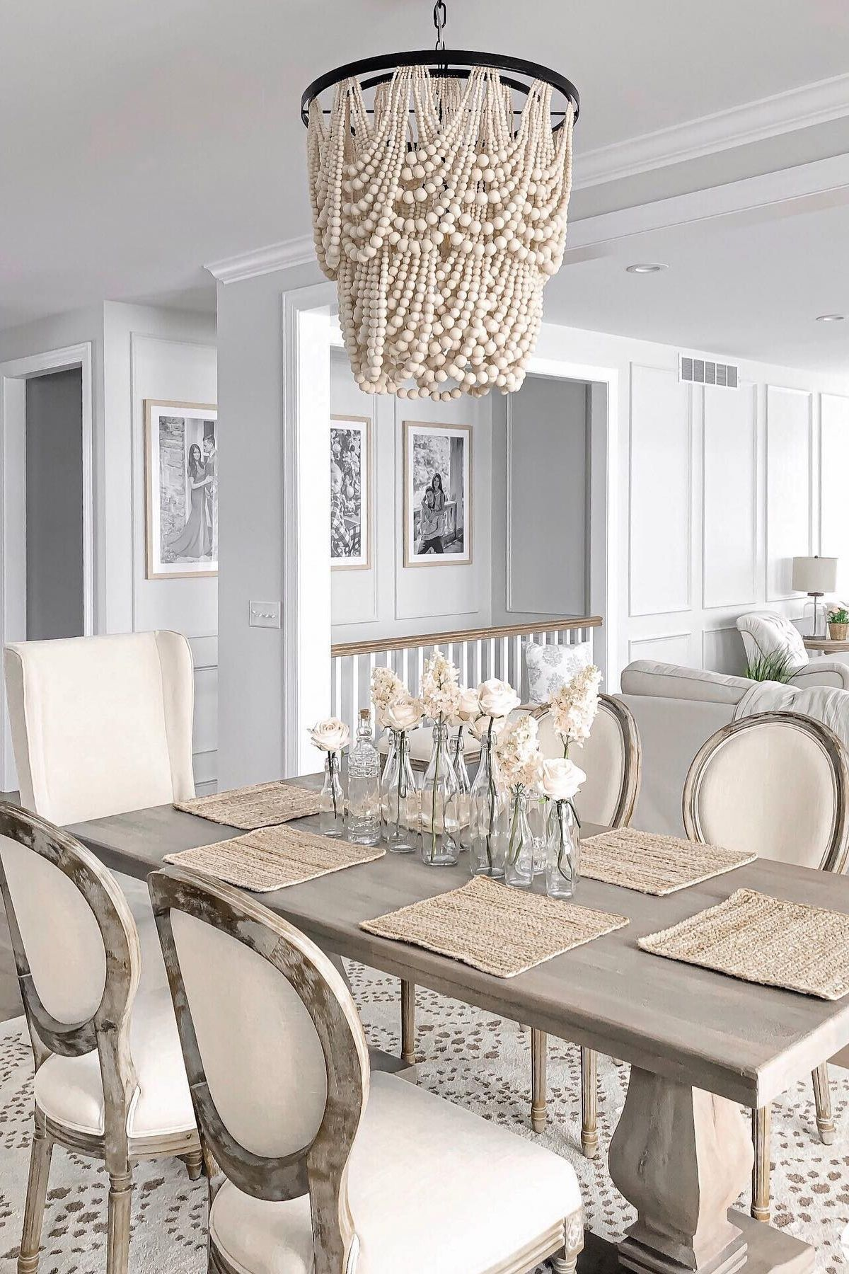 Modern Rustic Farmhouse Dining Room With Silk Flower Accents In 2020 Farmhouse Dining Room Farmhouse Dining Dining Room Table Decor