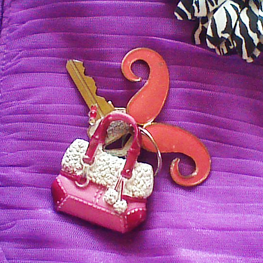DIY personalized key charms. To reflect my style. From just a Barbie bag and moustache pendant.