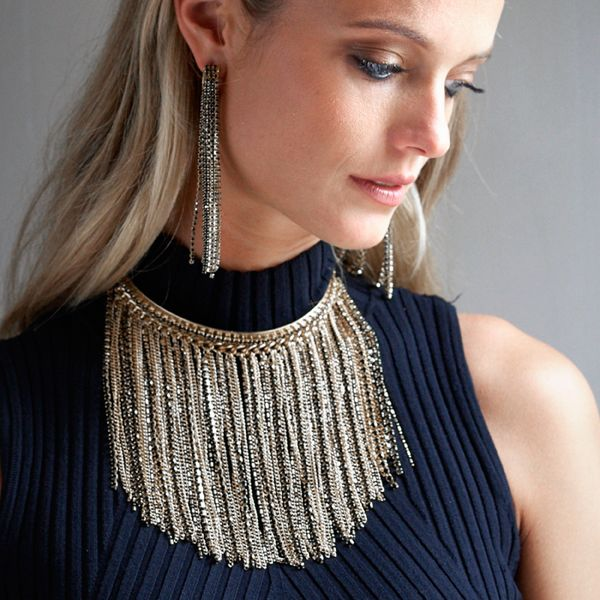 Want that wow factor? Add stunning statement jewelry—like our tiered chain necklace and earrings—to a classic black mock neck. Be sure to keep any other accessories—shoes, bag, belt—simple to make the most impact.