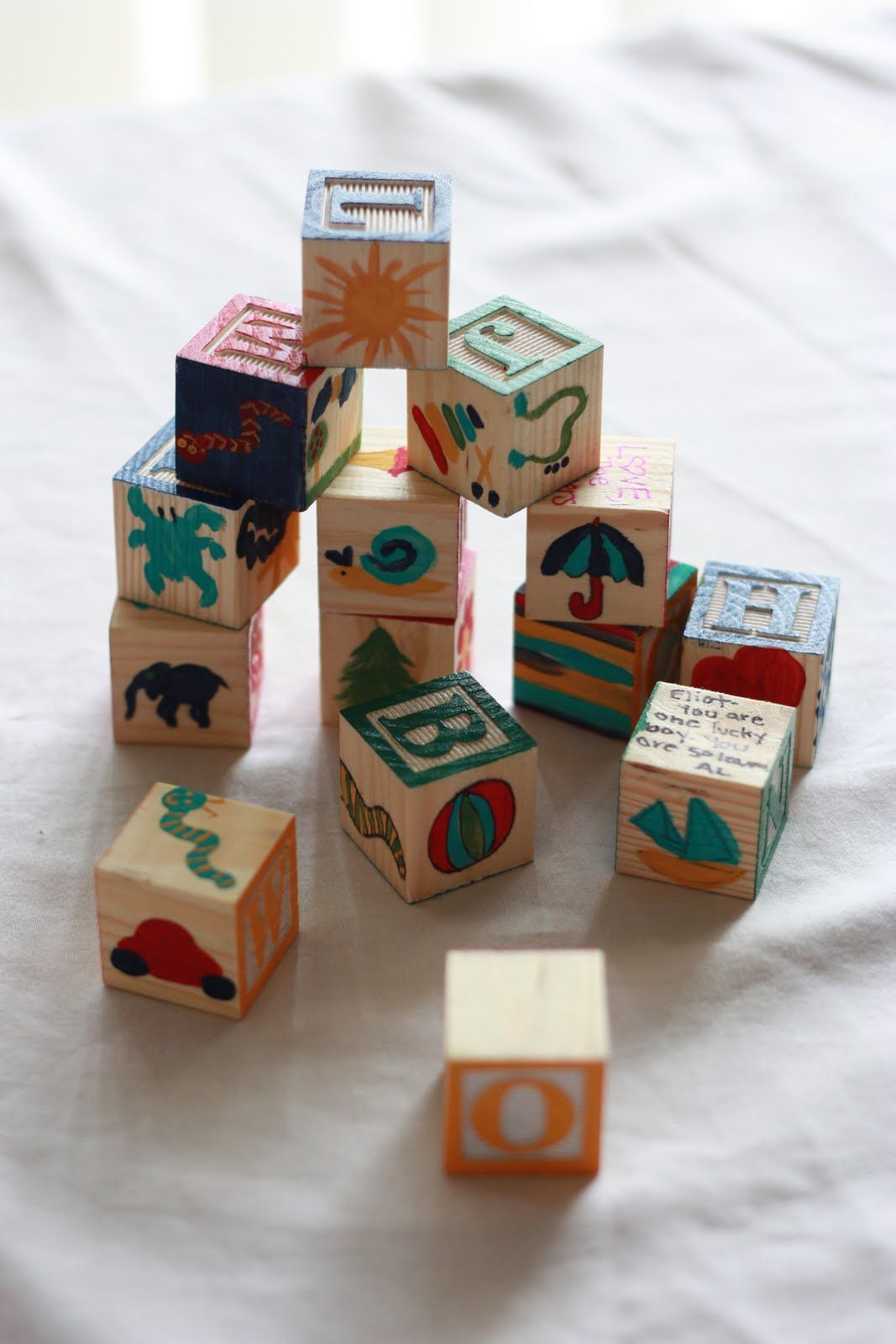 Cute Shower Idea Have Guests Paint Blank Sides Of Alphabet Blocks Baby Shower Crafts Baby Shower Inspiration Baby Blocks Baby Shower