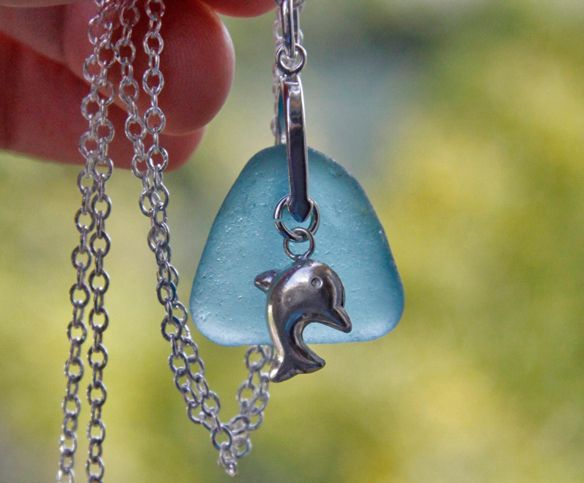 Cosmic Dolphin made with rare aqua marine sea glass and silver