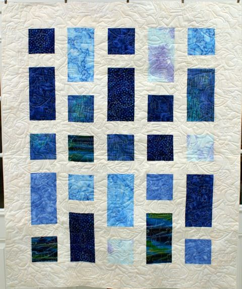 Quick lap quilt made with Batik fabrics.  November 14, 2014.  'Chubbier' pattern by the Teacher's Pet pattern company.  Quilting by the Quilted Cricket.