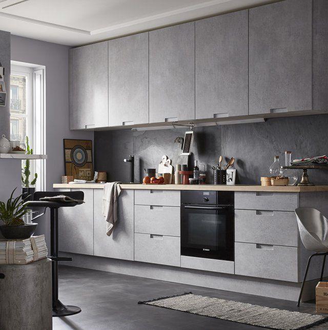 Idée relooking cuisine Avec ses façades effet béton gris nuancé - deco maison cuisine ouverte