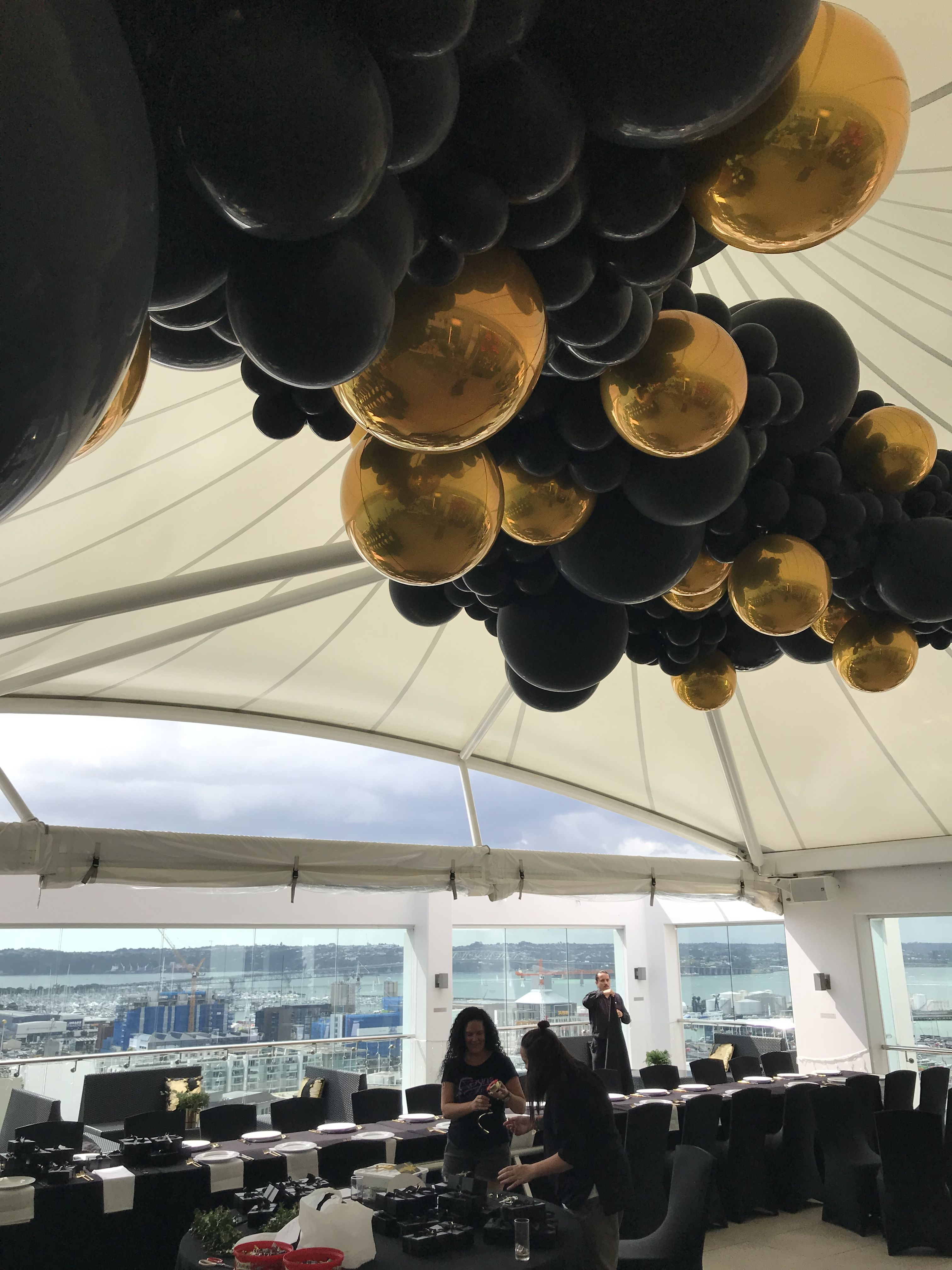 Black And Gold Balloon Installation Black And Gold Balloons