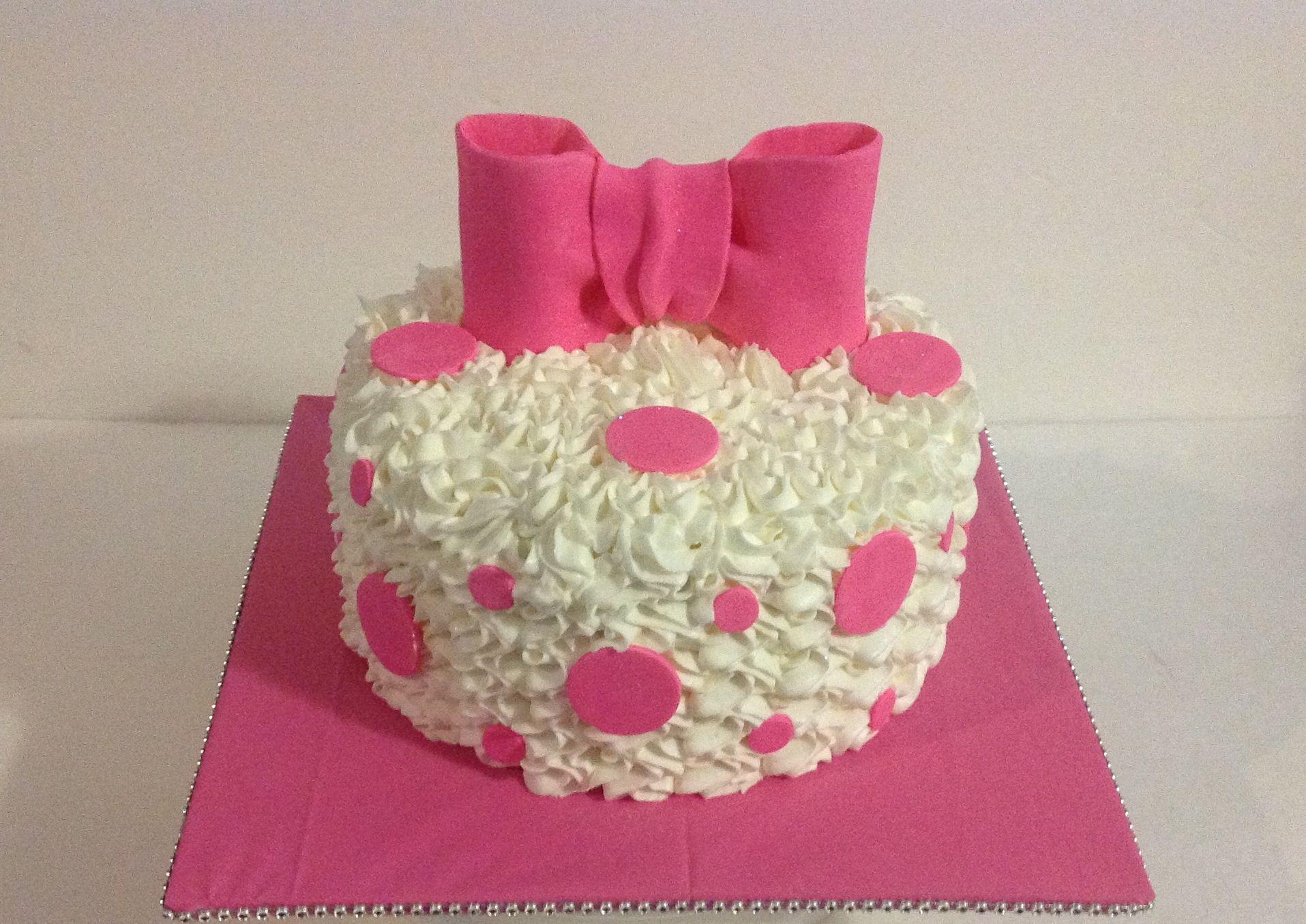 Pink polka dot and bow cake