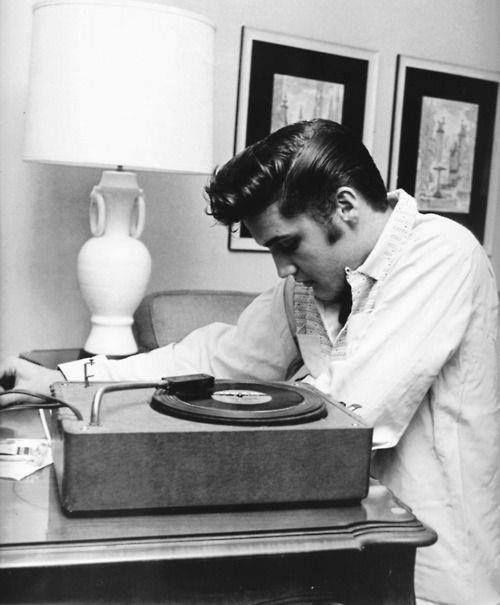 Elvis Presley plays a vinyl record. dstele.com