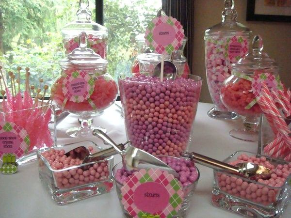 On tables... some kind of glass bowl or clear container and pink candies?