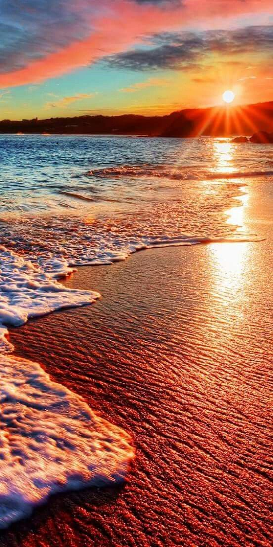 Brilliant vacation destination beach sunrise with colorful sand...
