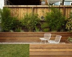 Planter Box Against Back Fence To Stop The Digging Escaping