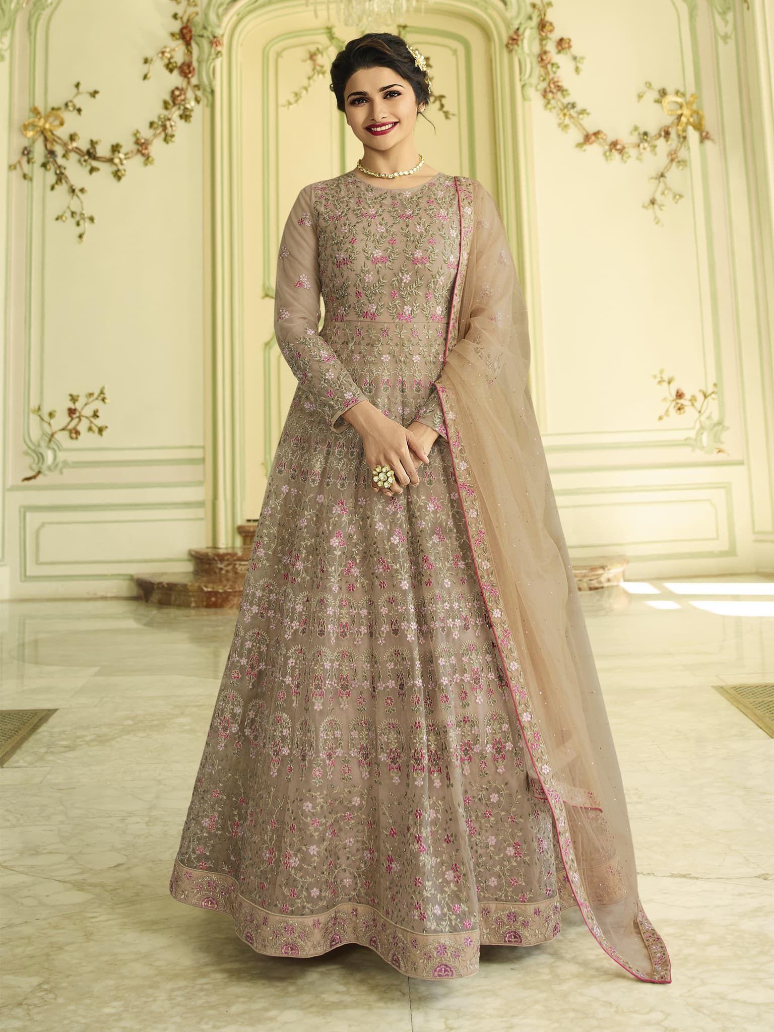 e08be8669e Beige Color Net Fabric Semi Stitch Dress Material. | Vastravibe in ...