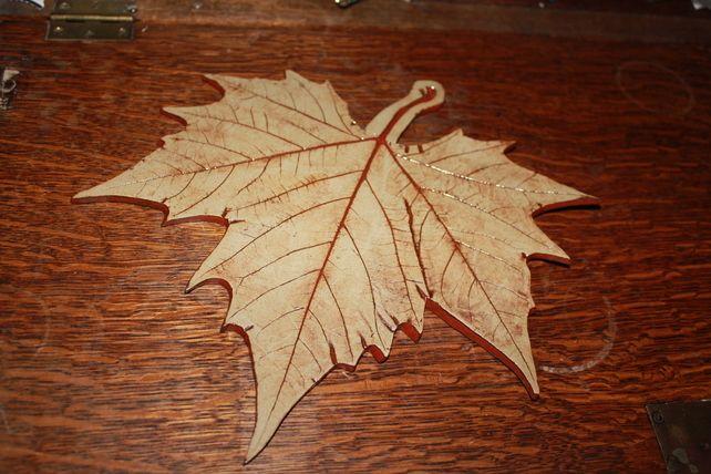 Handmade ceramic Leaf decoration finished in dark red glaze £25.00